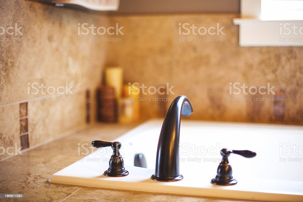 Bath Tub Soaking and Water Valves with Luxury Tile royalty-free stock photo