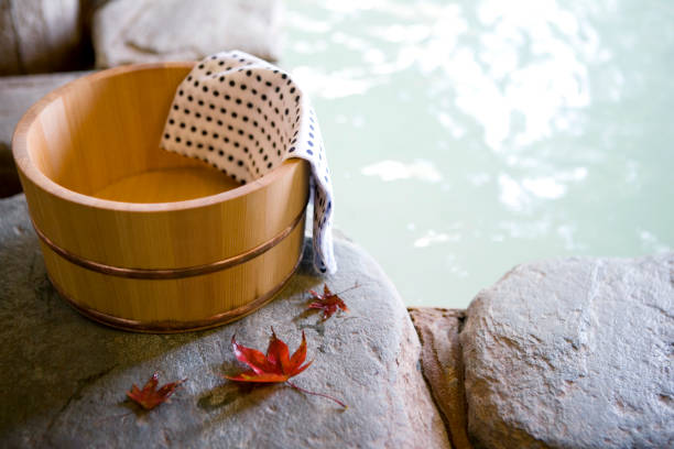 bath tub with autumn leaves - hot spring stock photos and pictures