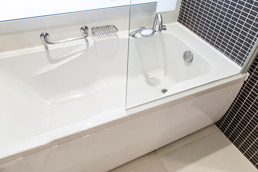 View of bath tube with day light from the window, very shallow depth of fieldView of bath tube with day light from the window, very shallow depth of field