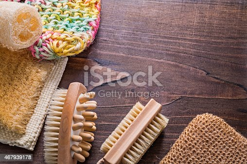 bath wisps loofah massagers on vintage wooden board with copyspace