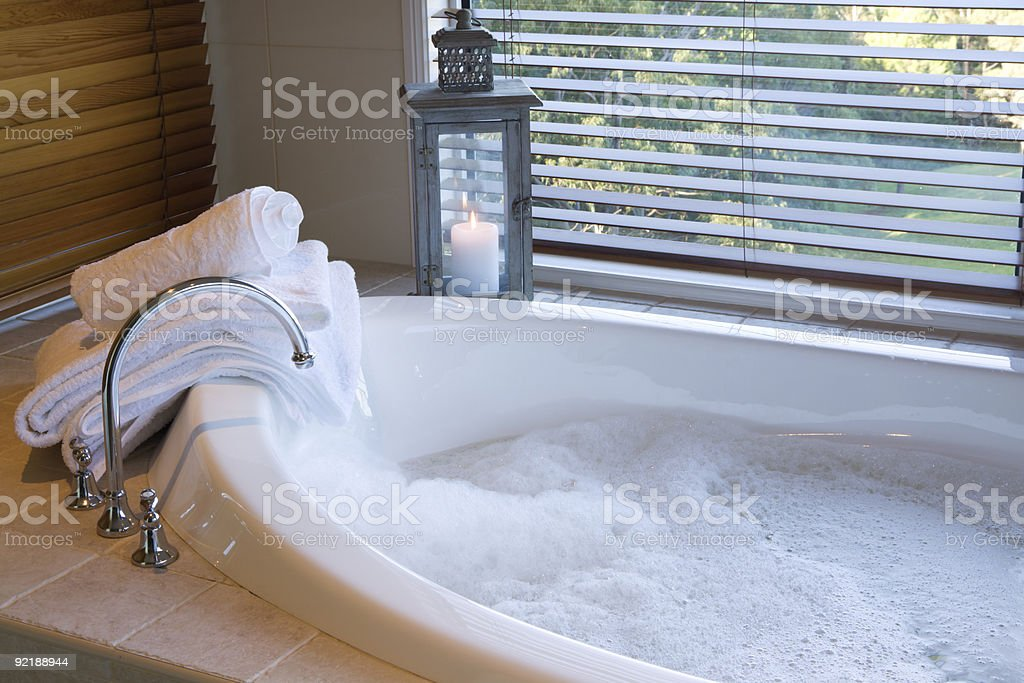Bath with bubbles, candle and a great view stock photo
