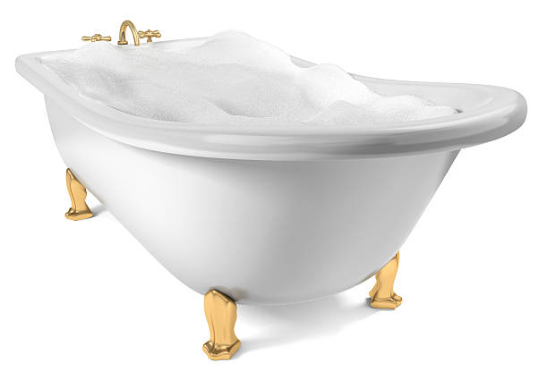Bath with golden legs filled with water and bubbles A Cast-Iron standing bathtub on white filed with soap suds with clipping path included bubble bath stock pictures, royalty-free photos & images