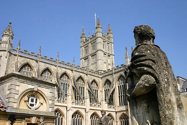 Bath,England Historical Bath, England. Statue in front of Bath Abbey . bath abbey stock pictures, royalty-free photos & images