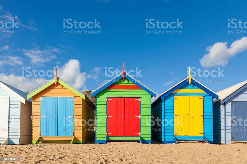 Bathing boxes in a beach with copyspace stock photo