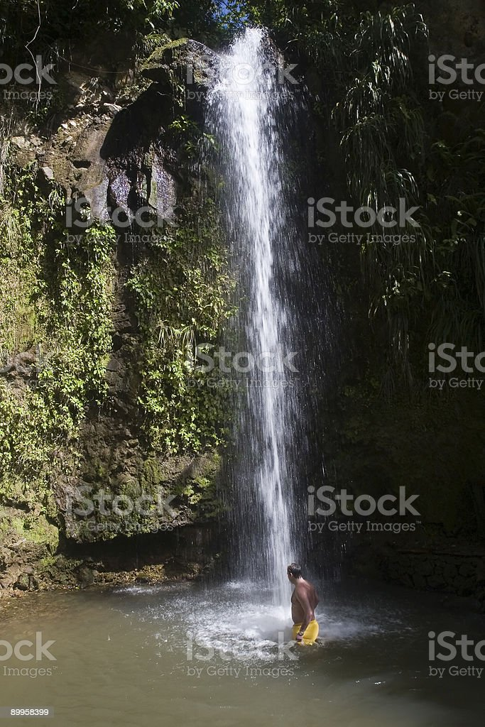 Bathing in a Tropical Waterfall royalty-free stock photo