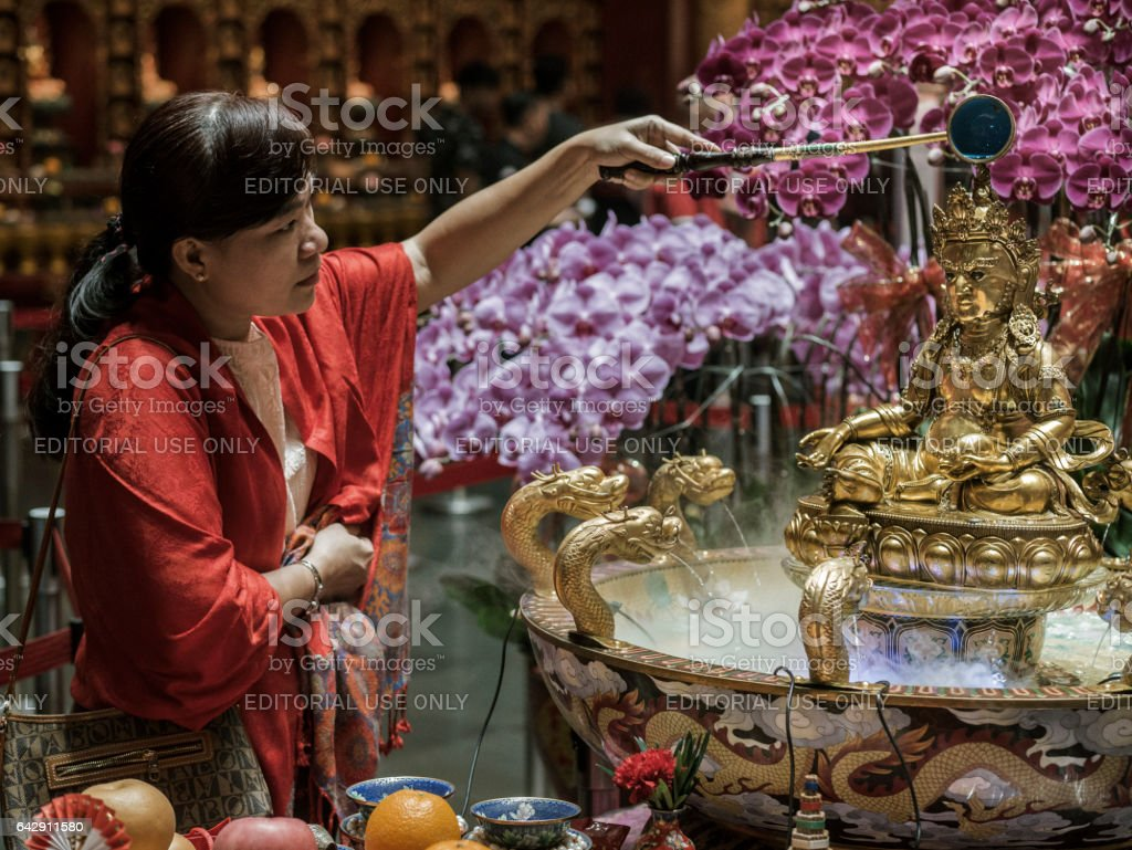 Bathing of Dzambhala ritual in Singapore stock photo