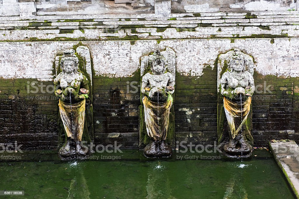 Bathing temple figures at the Goa Gajah Temple in Bali stock photo