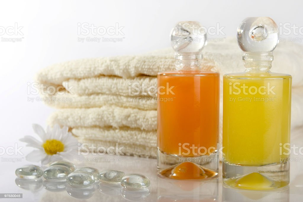 bathingfoam bottles with towels royalty-free stock photo