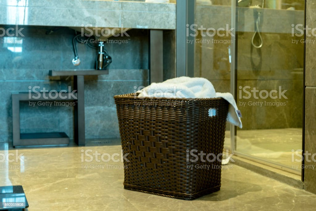 bathrobe basket in bathroom stock photo