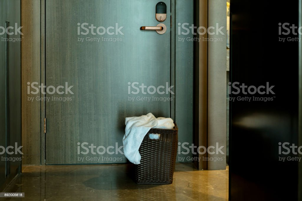 bathrobe basket on doorway waiting for room service stock photo
