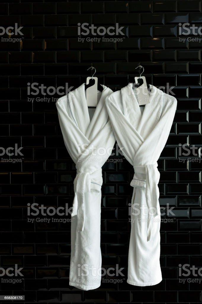 Bathrobe for couple hang on black wall – Foto