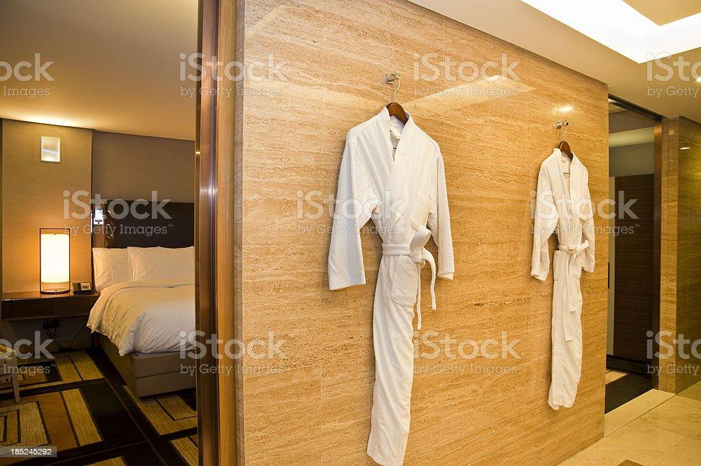 Bathrobe in hotel bathroom royalty-free stock photo