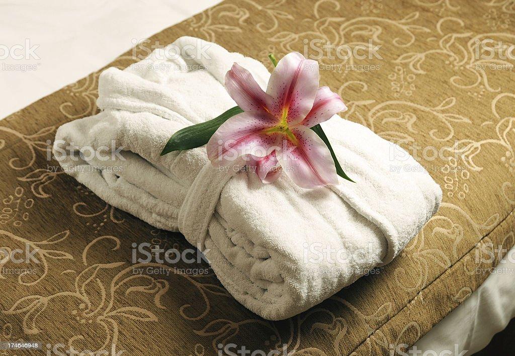 Bathrobe on the bed stock photo