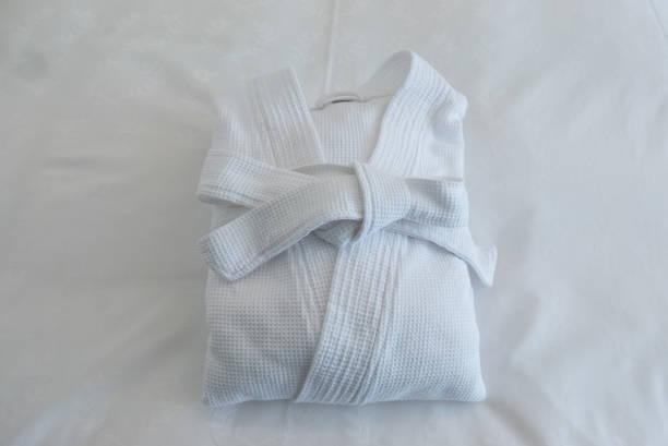 bathrobe robe white isolated bath folded shower spa - accappatoio foto e immagini stock