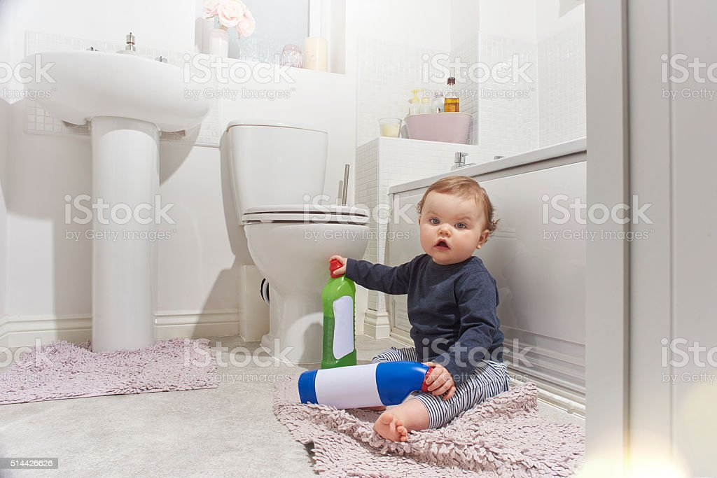 Bathroom dangers for baby stock photo