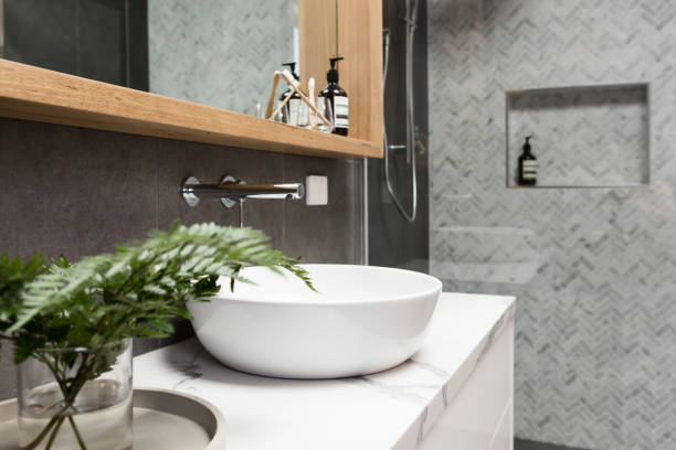 bathroom details clean white basin with shower tiling behind - bathroom renovation stock photos and pictures