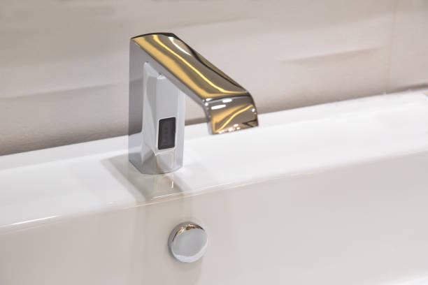 Bathroom faucet in polished chrome powered automatic by sensor. object about home Improvement. stock photo