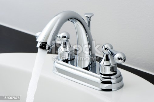 Chrome bathroom faucet with running water. More pictures...