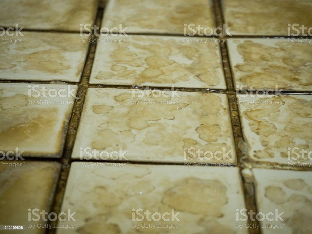 Trama di piastrelle bagno piano con posto acqua e alle macchie
