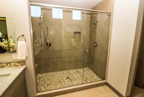 Bathroom Shower With Glass Door, Tile, Windows & Two Shower Heads