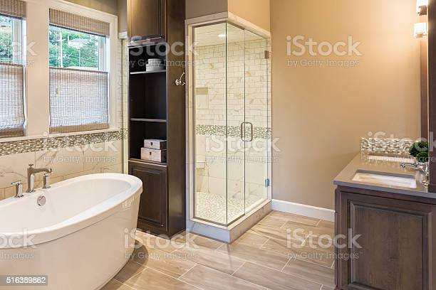 Bathroom in luxury home bathtub and shower picture id516389862?b=1&k=6&m=516389862&s=612x612&h=hrfwisvbkmko6br2hqa3dyn18mqfqzba5lwr85zkwgq=