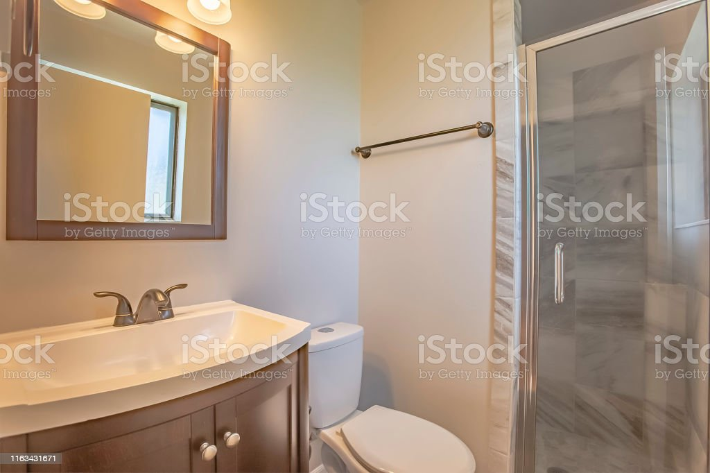 Bathroom interior of a home with toilet sink and cabinet against the...