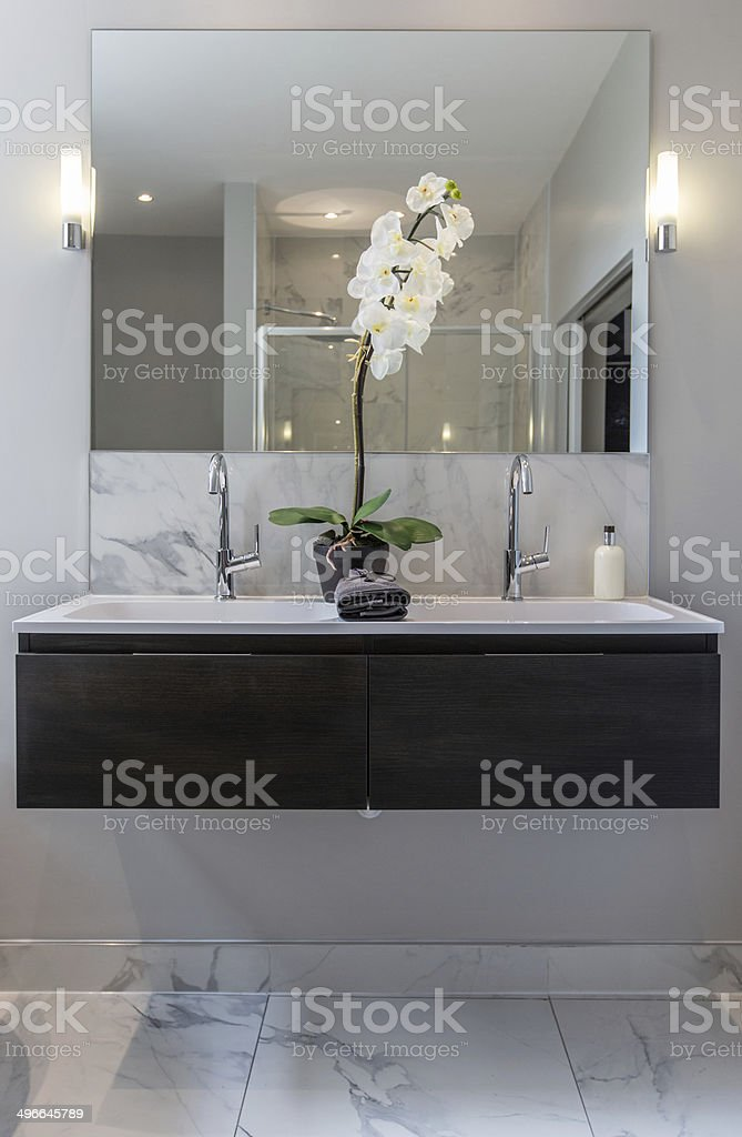 Bathroom Interior with wash-stand and mirror stock photo