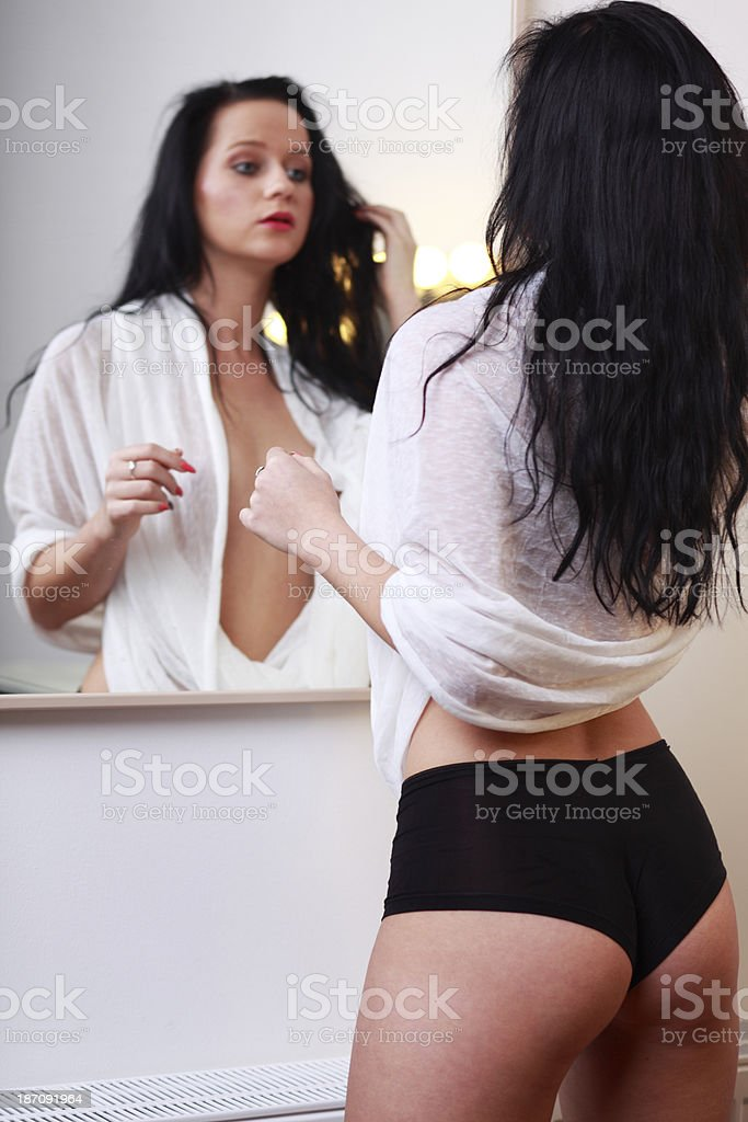 Bathroom mirror and young girl royalty-free stock photo