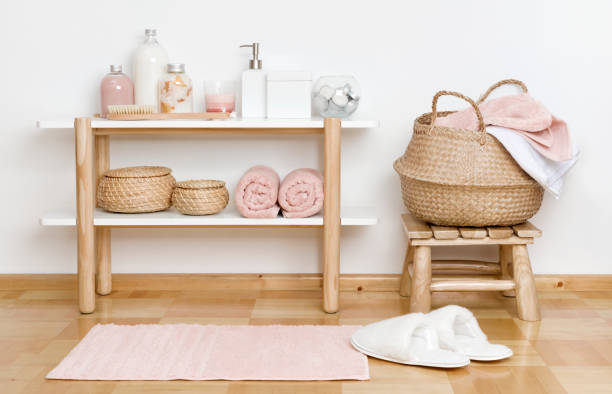Bathroom partial interior with wooden shelf, stool and spa products stock photo