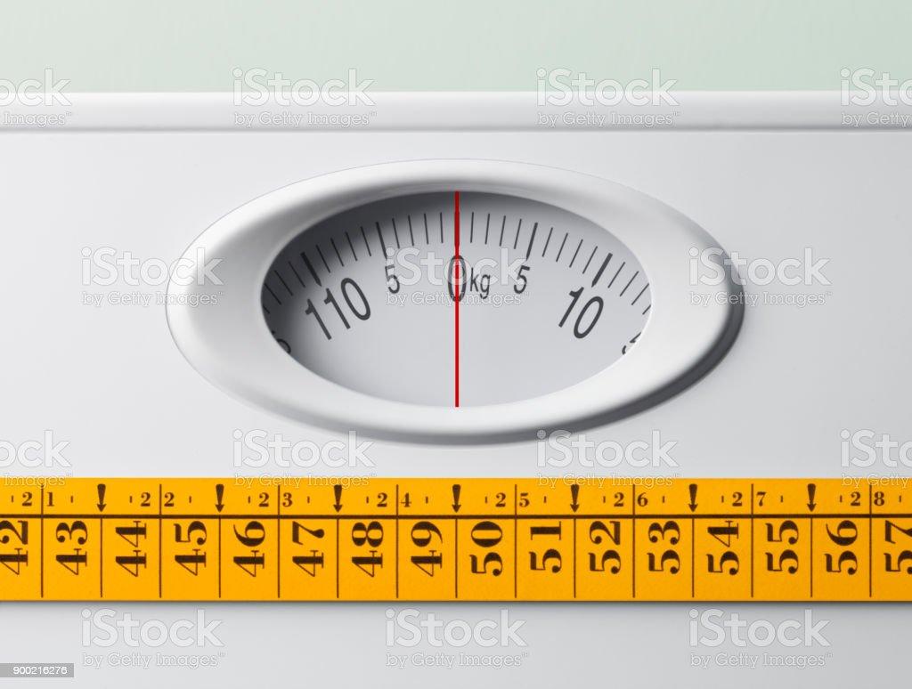 Bathroom scale with tape measure Bathroom scale with tape measure. Balance Stock Photo