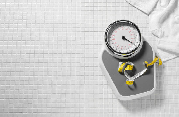 bathroom scales and tape measure - weights stock photos and pictures