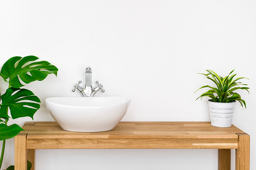istock Bathroom simple interior with washbasin and faucet on wooden pedestal 1060907460