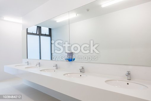 White bathroom sink countertop with copy space
