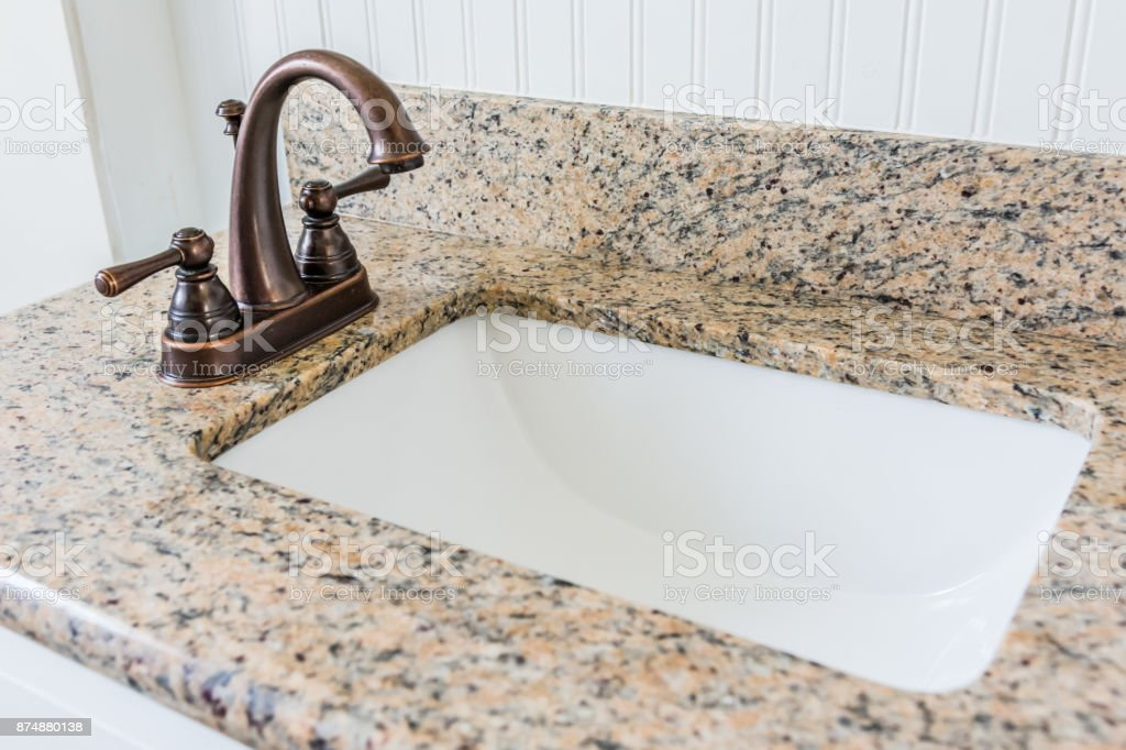 Bathroom Sink Granite Counter Bronze Faucet And White ...