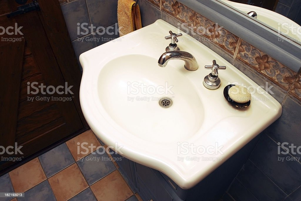 Bathroom Sink in a Country Cottage royalty-free stock photo