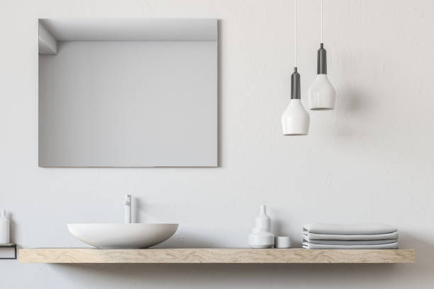 Bathroom sink, square mirror close up stock photo