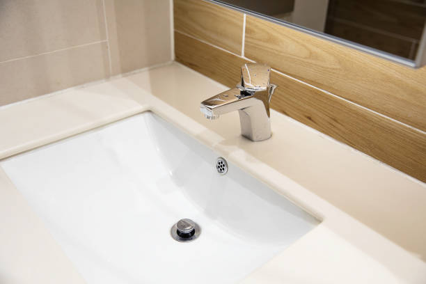 Bathroom sinks and faucets stock photo