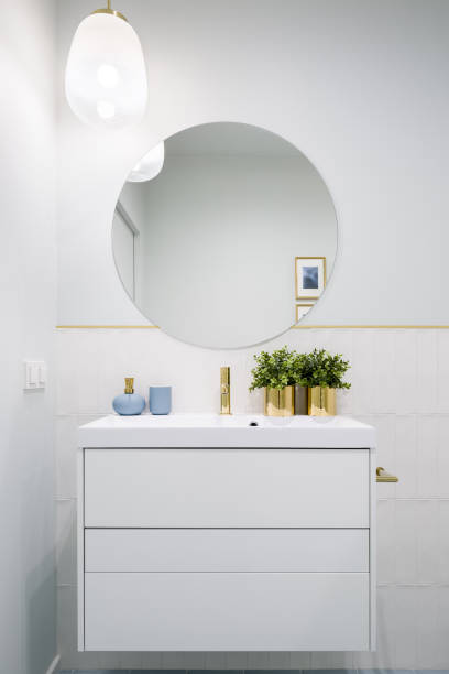 Bathroom with round mirror stock photo