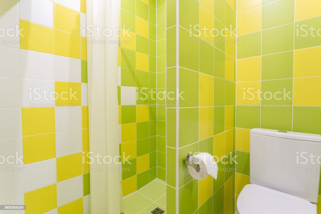 Bathroom with shower, toilet bowl and sink. Hotel standart bedroom. simple and stylish interior. interior lighting zbiór zdjęć royalty-free