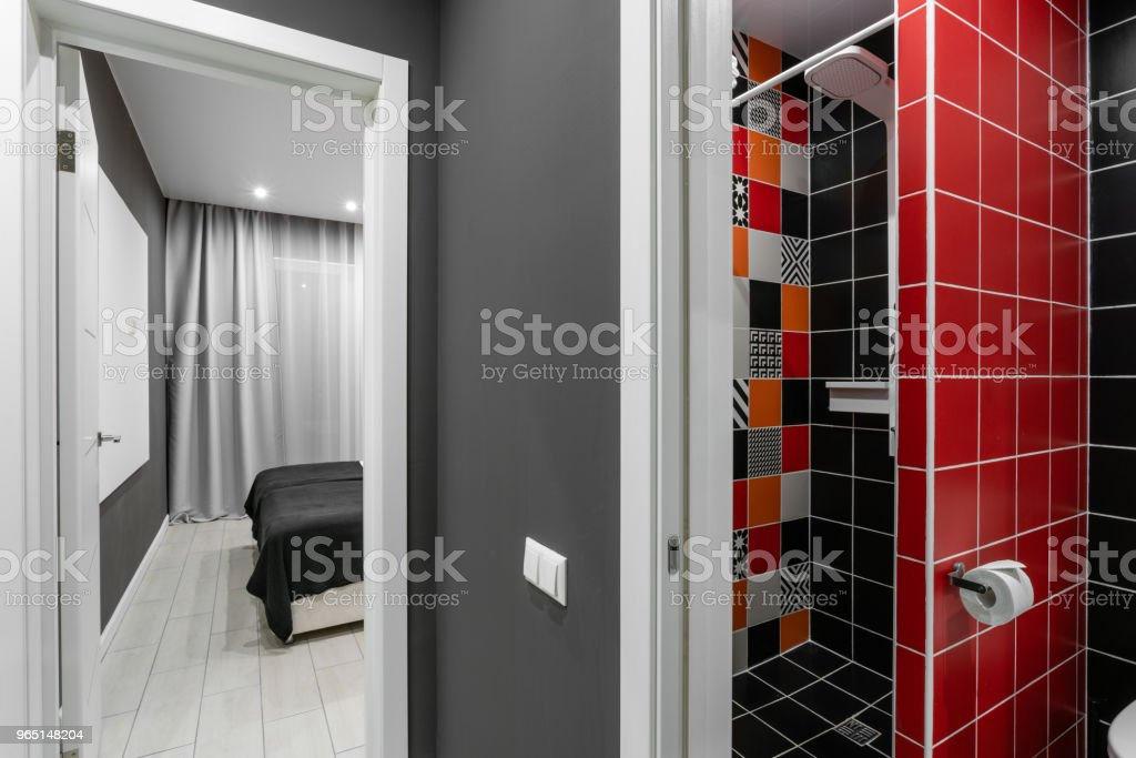 Bathroom with shower, toilet bowl and sink. Hotel standart bedroom. simple and stylish interior. interior lighting royalty-free stock photo