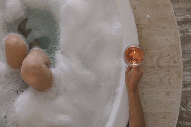 Bathroom with wine Bathroom with wine bubble bath stock pictures, royalty-free photos & images