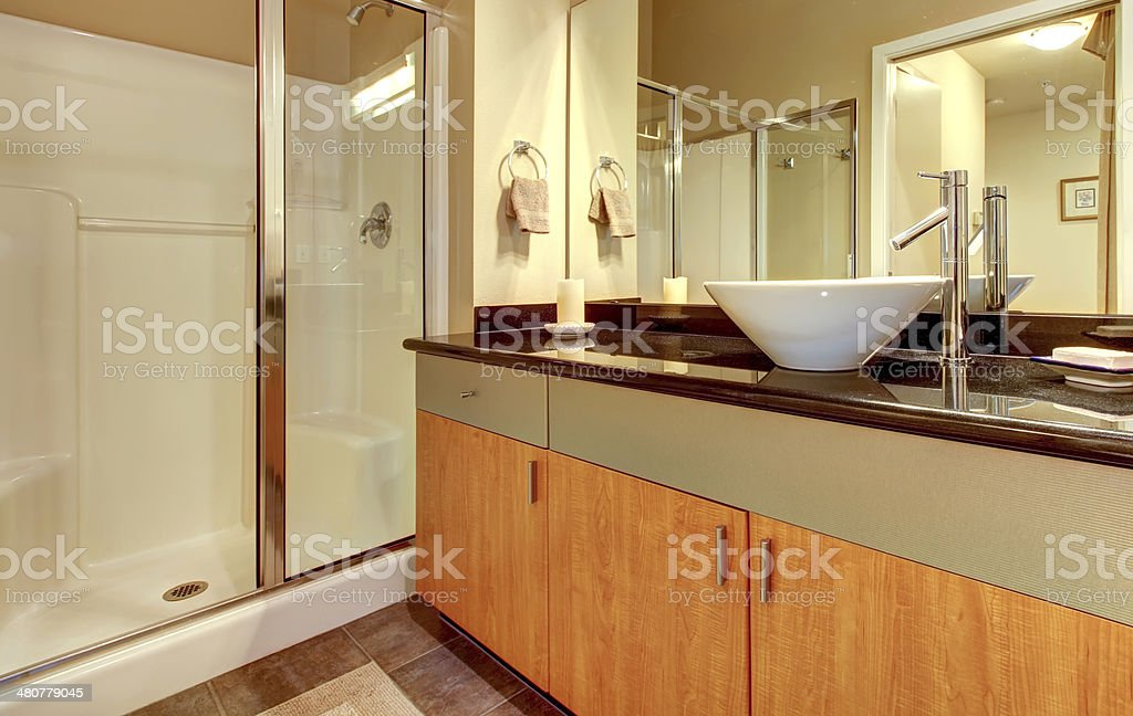 Bathroom With Wood Modern Cabinets And White Sink Stock Photo Download Image Now Istock