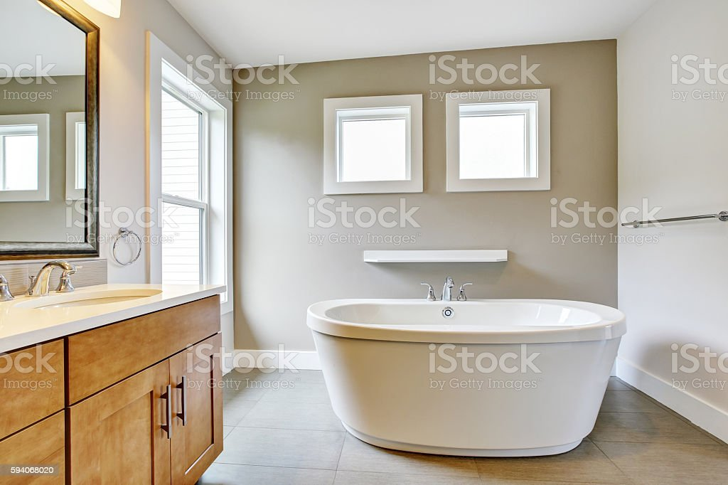 Bathroon interior with vanity cabinet, two sinks and bath tub. stock photo