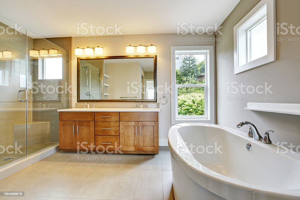 Bathroon  with vanity cabinet and shower area with glass doors stock photo