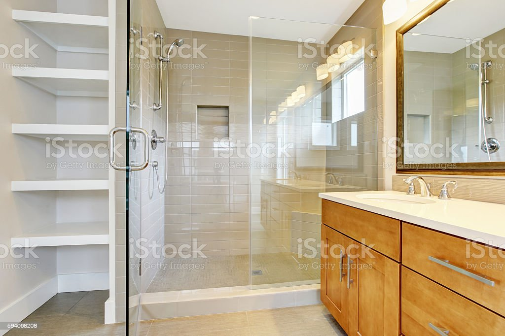 Bathroon with vanity cabinet, two sinks and glass shower door stock photo