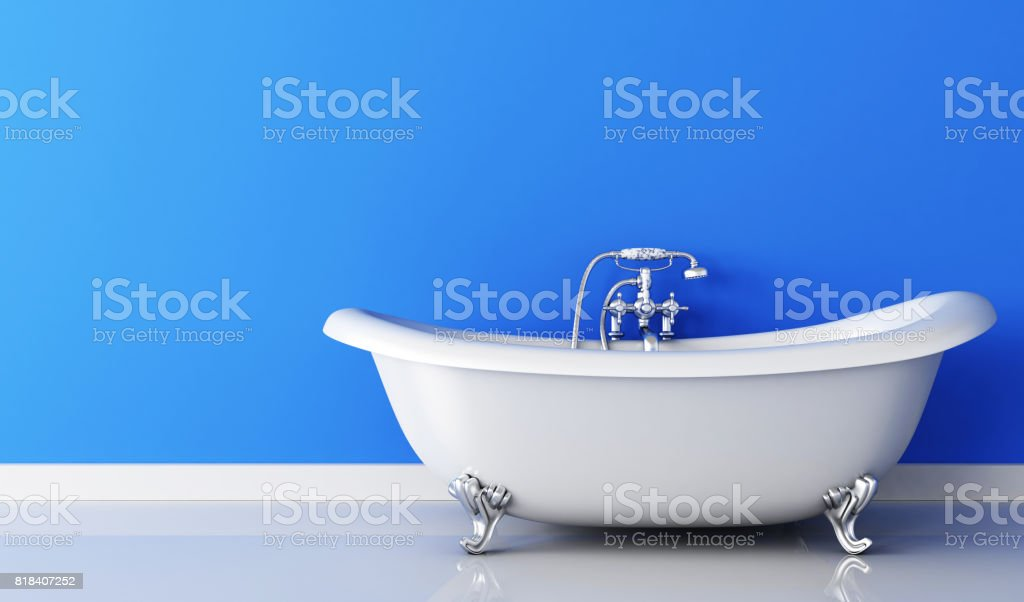 Bathtub and faucet and blue wall stock photo