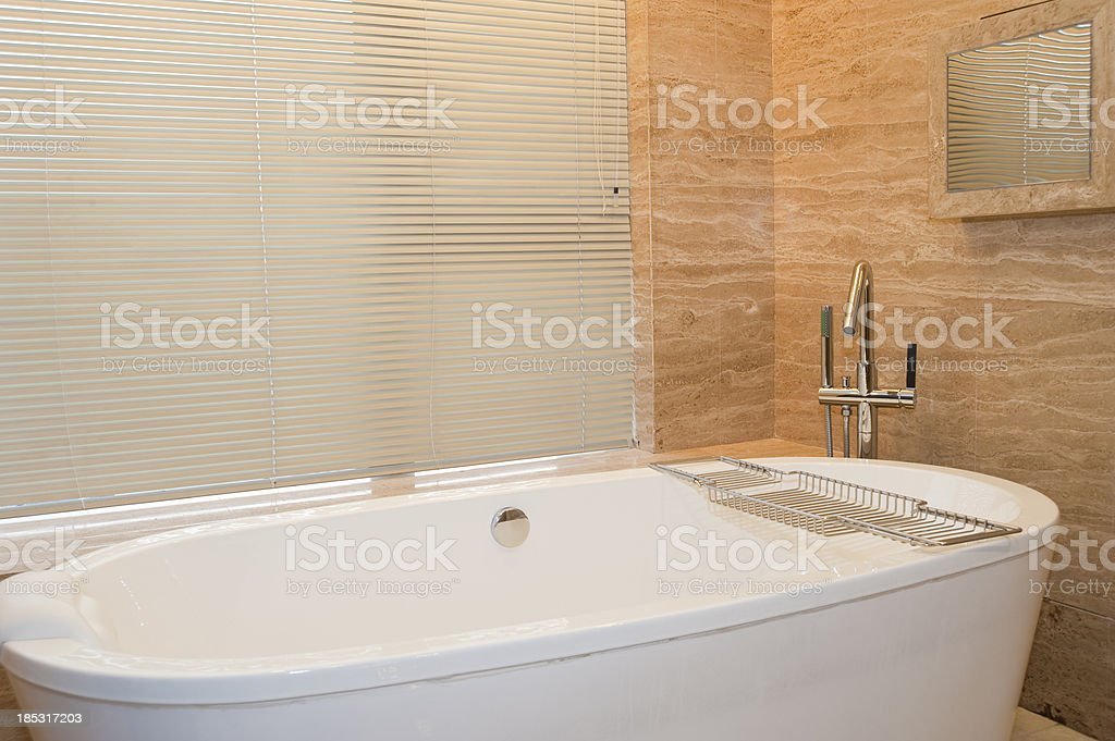 Bathtub in hotel room royalty-free stock photo