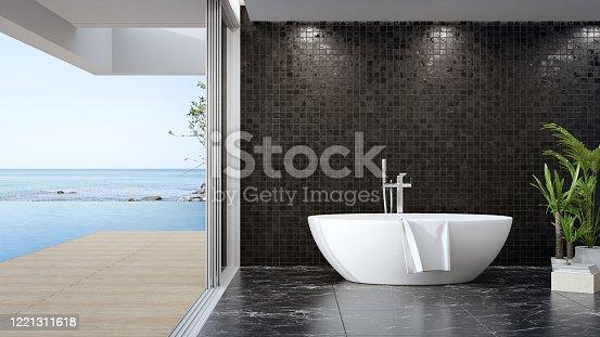 istock Bathtub on black marble floor of large bathroom in modern house or luxury pool villa. 1221311618