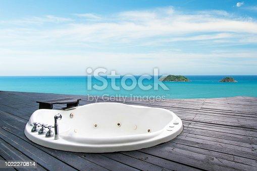 istock bathtub on the beautiful beach and sea 1022270814