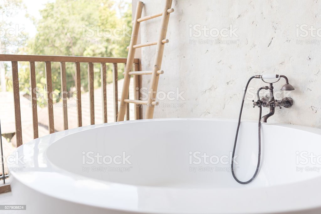 bathtub with vintage style faucet stock photo